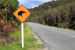 Kiwi Crossing Sign. On the road in Westland National Park, South Island, New Zealand stock photo