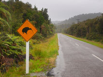 Kiwi Crossing Sign in Rain. Kiwi Crossing Sign on a Casual Rainy Day in Westland, New Zealand royalty free stock image