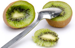 Kiwi cut in half with a spoon Stock Photo