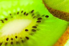 Kiwi cut by segments Stock Photos