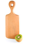 Kiwi with cutting board Royalty Free Stock Photography