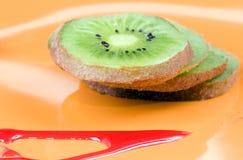 Kiwi dessert. Macro shot of KIWI dessert on orange dish Royalty Free Stock Image