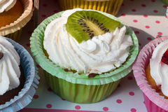 Kiwi dessert fruit tart pastry with whipped cream Stock Photo