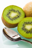 Kiwi and dessert spoon Stock Photos