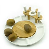 Kiwi on plate. Kiwies on a white china fruit plate Royalty Free Stock Photography