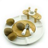 Kiwi on plate. Kiwies on a white china fruit plate Stock Photos