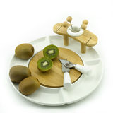 Kiwi on plate. Kiwies on a white china fruit plate Royalty Free Stock Images