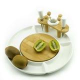 Kiwi on plate. Kiwies on a white china fruit plate Royalty Free Stock Photo
