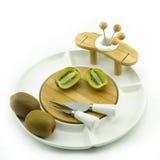 Kiwi on plate. Kiwies on a white china fruit plate Royalty Free Stock Photos