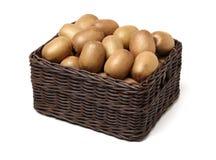 Kiwi dorato Actinidia chinensis del taglio ed intero del kiwifruit/ immagini stock