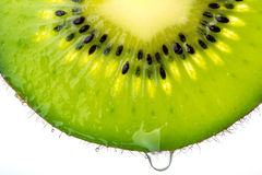 Kiwi and drop. Piece of kiwi and a drop of juice Stock Image