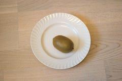 Kiwi eating. Kiwi  diets curve drink eating energy exoticism Royalty Free Stock Photo
