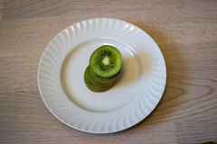 Kiwi eating. Kiwi  diets curve drink eating energy exoticism Stock Photography
