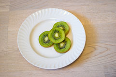 Kiwi eating. Kiwi  diets curve drink eating energy exoticism Royalty Free Stock Photography