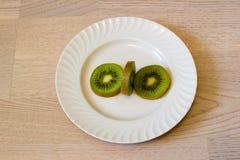 Kiwi eating. Kiwi  diets curve drink eating energy exoticism Royalty Free Stock Photos