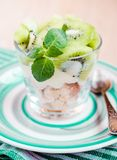 Kiwi Eton mess. Dessert with meringue, whipped cream and fruits Stock Images