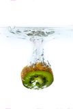 Kiwi falls into the water covered with splashes Royalty Free Stock Image