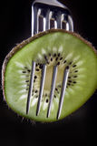 Kiwi on a fork Stock Photos