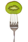 Kiwi on fork Stock Photo