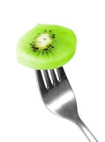 Kiwi on fork Royalty Free Stock Photos