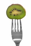 Kiwi on fork Stock Photography