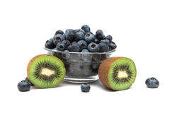 Kiwi and fresh blueberries on a white background Royalty Free Stock Images