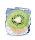Kiwi frozen in the ice cube close-up  on white background Stock Photography