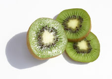 Kiwi fruit. Sliced kiwi fruit on a pure white background stock photography