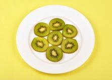 Kiwi fruit. Slice pieces of kiwi fruits on plate Stock Image