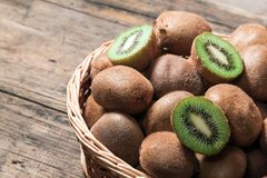 Kiwi Fruit. Whole and sliced - background Stock Image