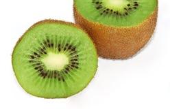 Kiwi fruit. Two halfs of kiwi fruit over white surface Stock Photo