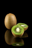 Kiwi fruit. On black with reflection Stock Image
