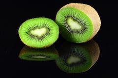 Kiwi Fruit. Reflection of kiwi fruit isolated from black background Stock Photos