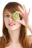 Kiwi fruit. Young woman holds kiwi in front of her eye Stock Photography