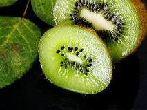 Kiwi fruit. Kiwi and leaves shallow dof Royalty Free Stock Photos