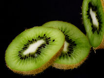 Kiwi fruit. Kiwi sliced up over black royalty free stock photography