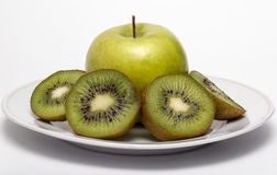 Kiwi fruit and apple Stock Photos