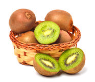 Kiwi fruit on the basket isolated on white Royalty Free Stock Photo