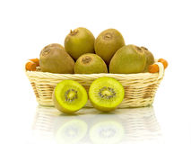 Kiwi Fruit in a basket on a white background Stock Photography