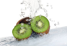 Kiwi fruit being washed isolated Royalty Free Stock Photos