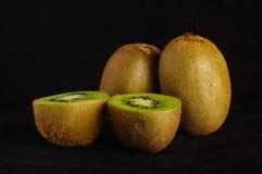 Kiwi fruit  on the black background Royalty Free Stock Photo
