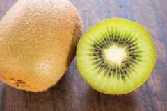 Kiwi fruit on brown wooden background Royalty Free Stock Photos