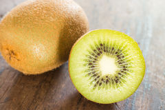 Kiwi fruit on brown wooden background Stock Photography
