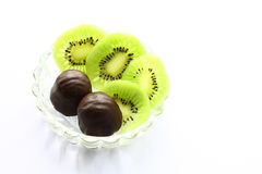 Kiwi fruit and chocolate. Kiwi fruit and chocolate - a delicious dessert Stock Images