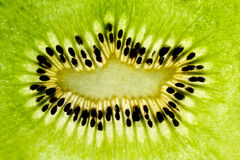 Kiwi fruit. Close up of green kiwi fruit center. Macro photography Stock Image