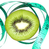 Kiwi Fruit. Closed up of Kiwi fruit and meter tape in high key light Stock Photo