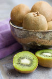 Kiwi Fruit Cut and in Bowl Royalty Free Stock Photos