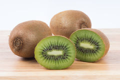 Kiwi fruit cut on chopping board Royalty Free Stock Image