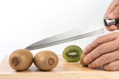 Kiwi fruit cut on chopping board Royalty Free Stock Photography