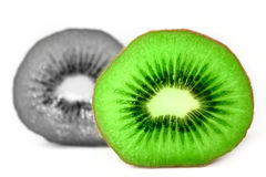 Kiwi fruit cut in half green and black Royalty Free Stock Images
